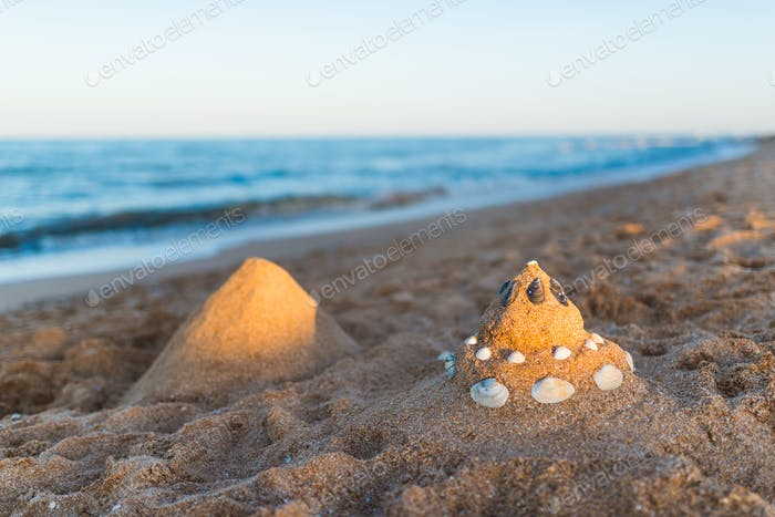 Two sand castle on the beach