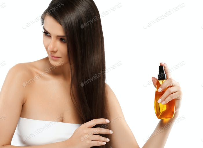 Beautiful long hair girl with oil cosmetic beauty skin care concept. Young woman female oil skincare