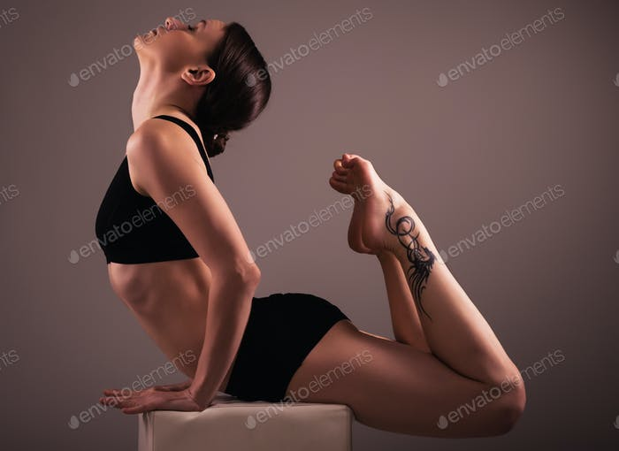 Brunette in black underwear does yoga asana