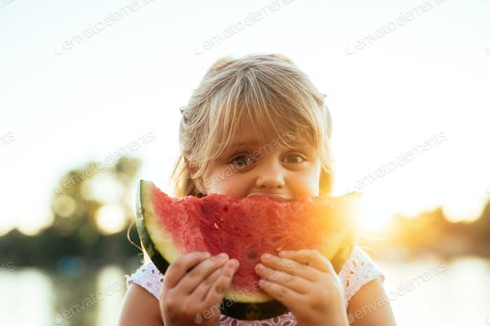 Enjoying eating watermelon