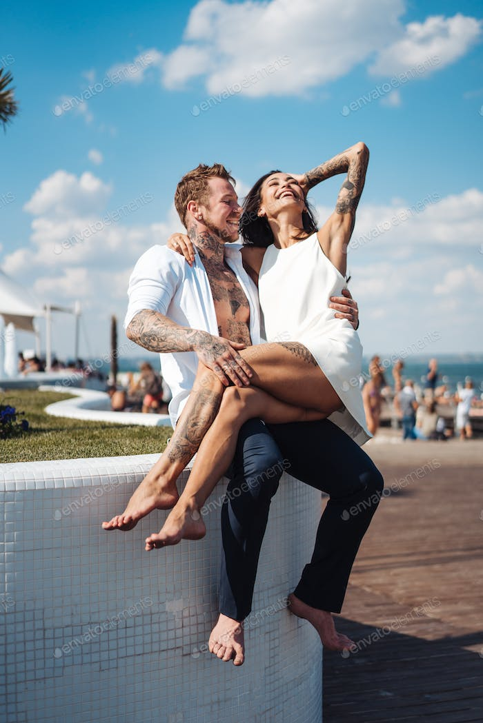 Girl and handsome guy outdoors