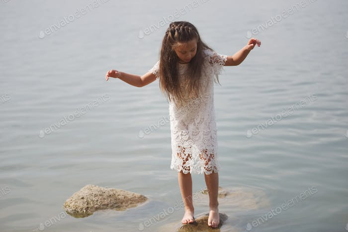 cute happy little girl in sumer lake