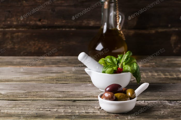 Olives with olive oil and basil