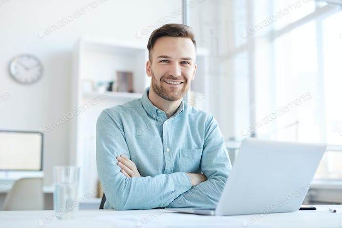 Young Businessman Posing at Workplace