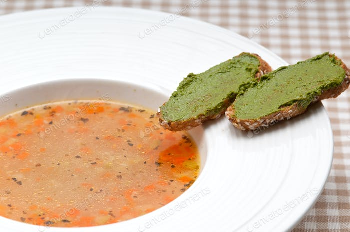 Italian minestrone soup with pesto crostini on side