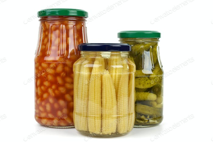 Glas jars with cornichons, haricot beans and corn ears