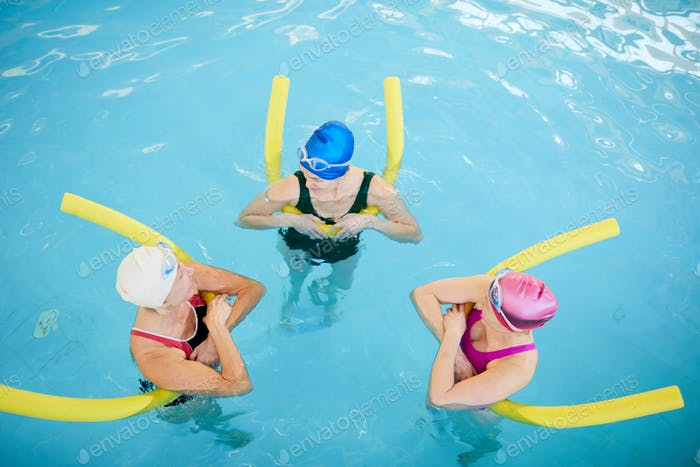 Three Mature Women Relaxing in Pool
