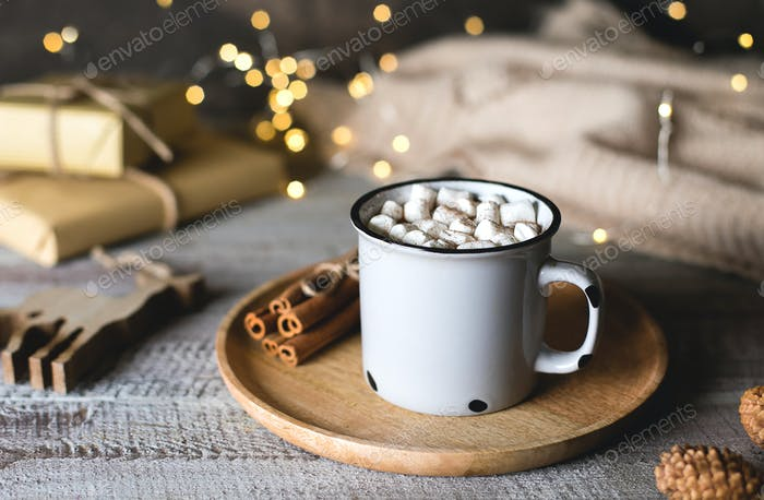 Christmas cocoa with marshmallow on wooden table background. Holiday drink with festive decoration