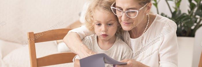 Grandma reading to little grandchild