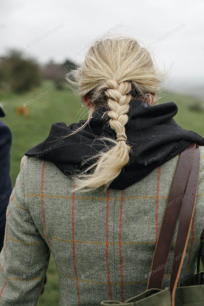 A woman in a warm tweed coat.