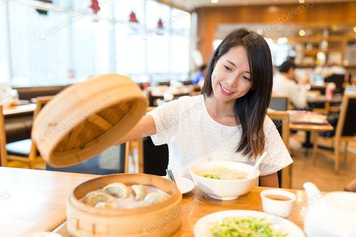 Woman enjoy in chinese restaurant