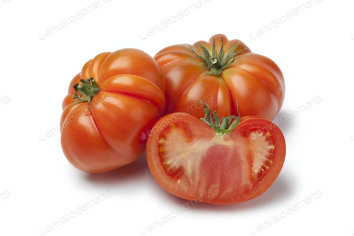 Organic whole and half Coeur de Boeuf tomatoes