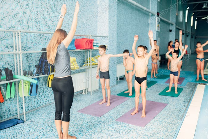 Instructor and group of children doing exercises