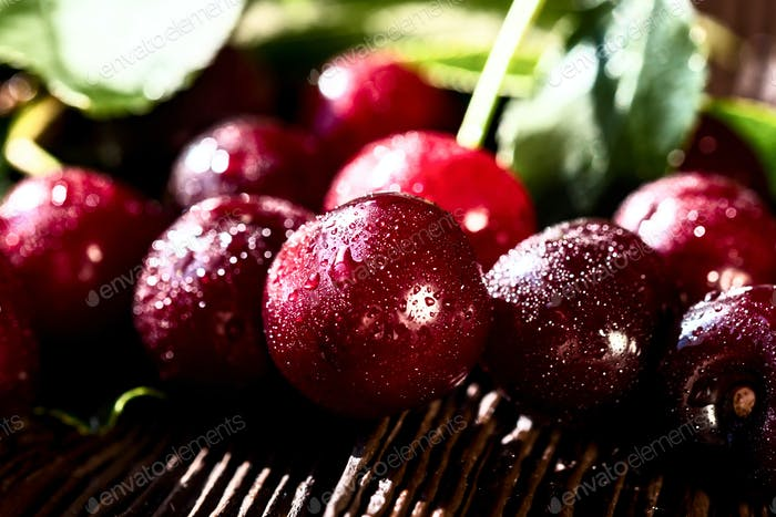 Sweet ripe cherries on wood background close