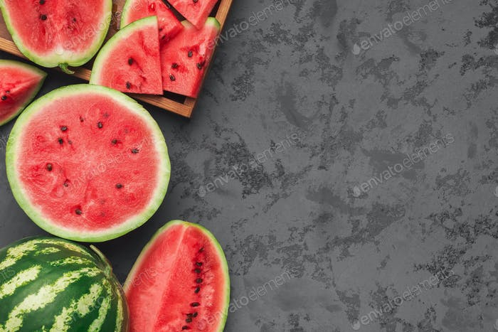 Ripe juicy watermelons on gray concrete background