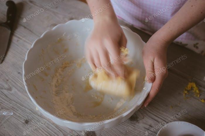 closeup of a woman artisan baker preparing dough at home