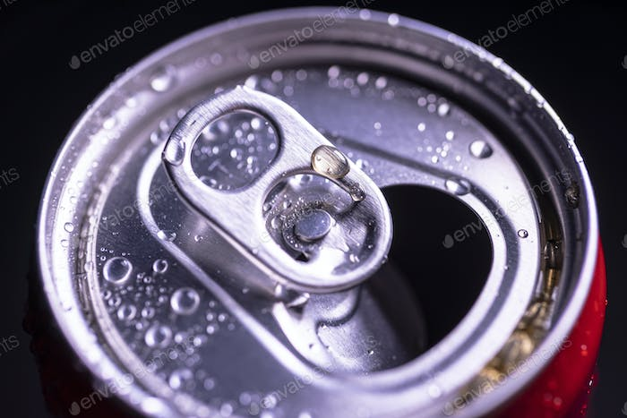 Open aluminum can with water drops or dew close-up macro shot