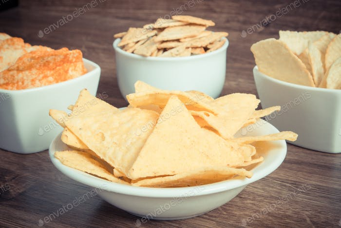 Vintage photo, Heap of crisps and cookies, concept of restriction eating unhealthy and salted food