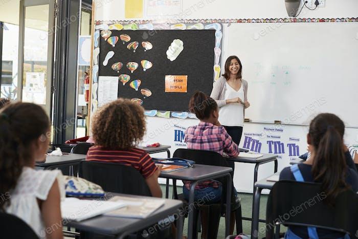 Female teacher taking elementary school class