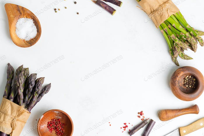 Food backdrop with bundles of fresh natural green and purple asparagus vegetables and different