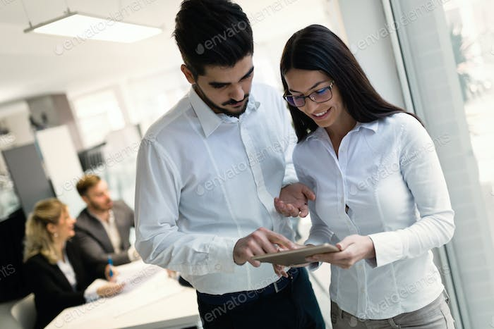 Young attractive architects using digital tablet in office