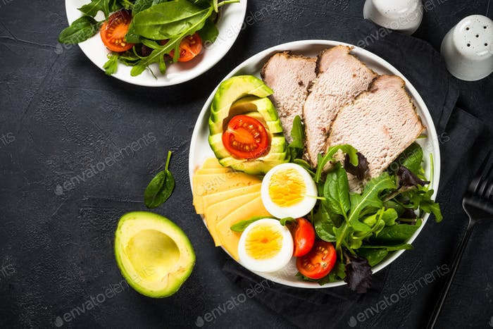 Keto diet plate on black stone table