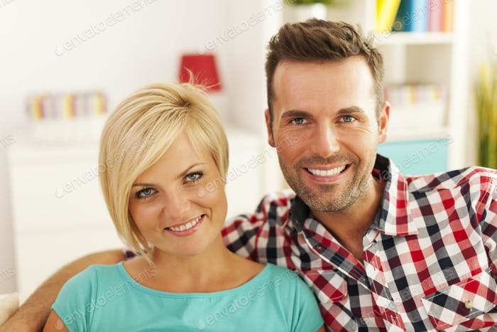 Portrait of smiling couple in living room