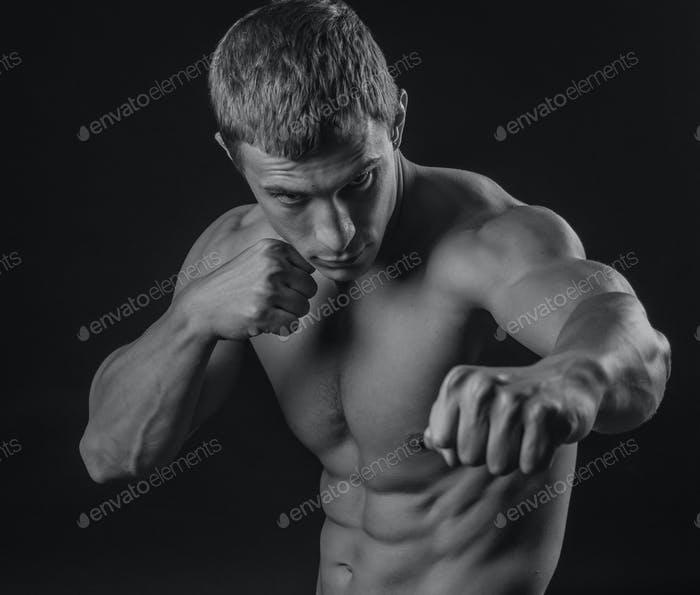 Young fit man shadow boxing