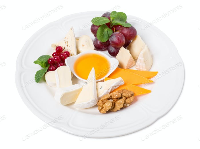 Delicious cheese platter with walnuts and honey.