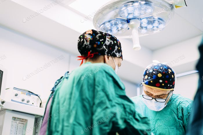 Team of Surgeons Operating in the Hospital.