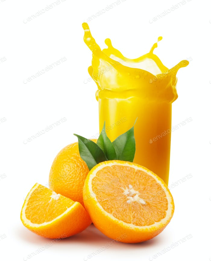 Splash of orange juice and oranges with leaves