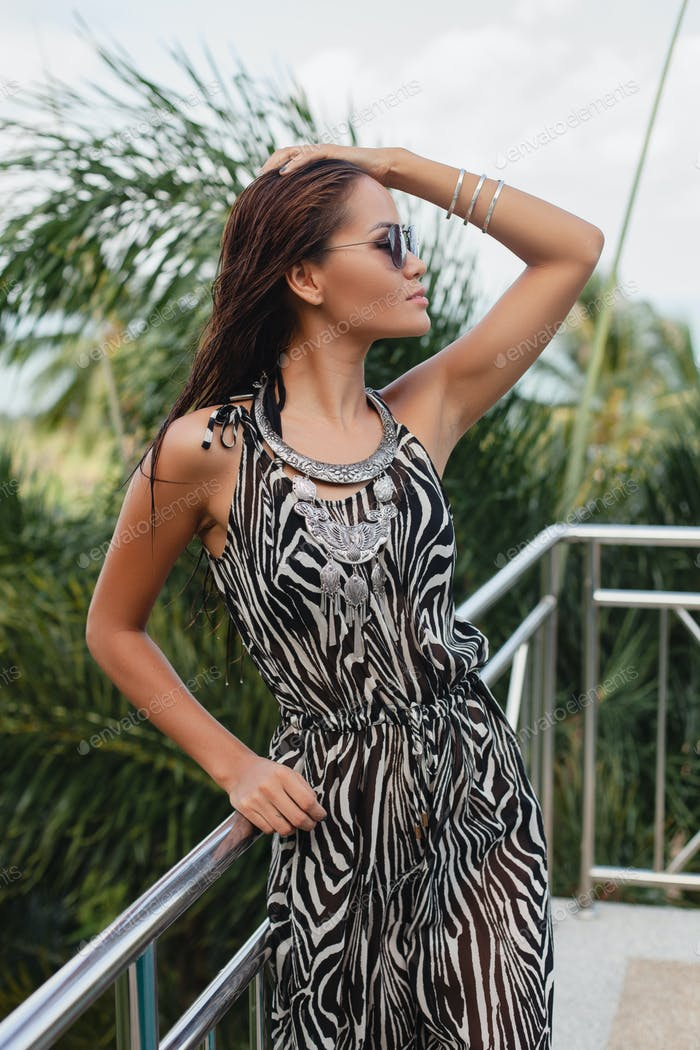 young asian sexy beautiful woman in tropical dress, zebra print