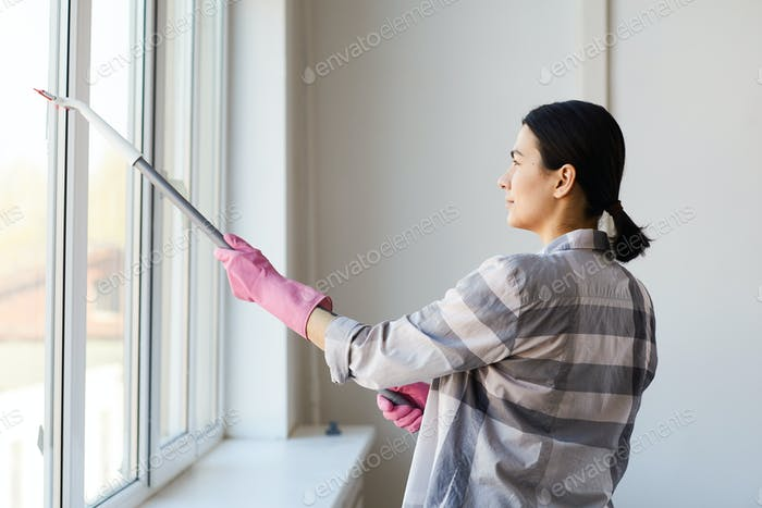 Woman cleaning the window