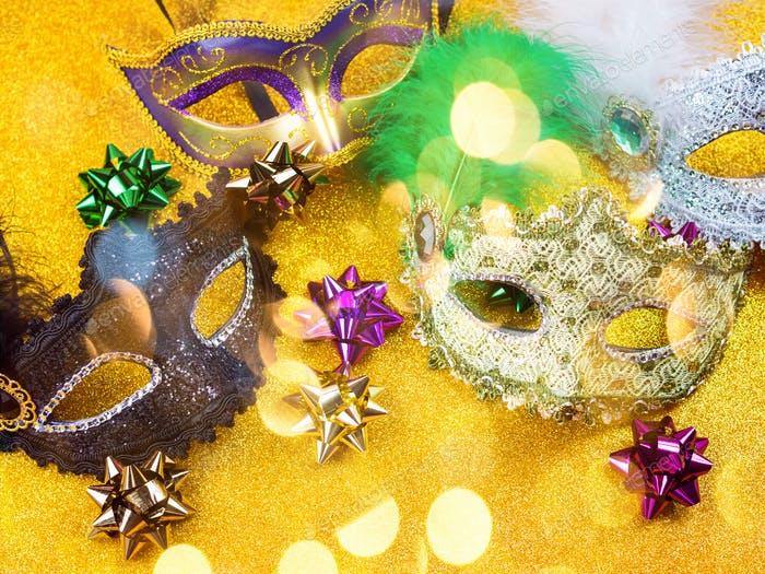 Colorful mardi gras carnival masks on golden