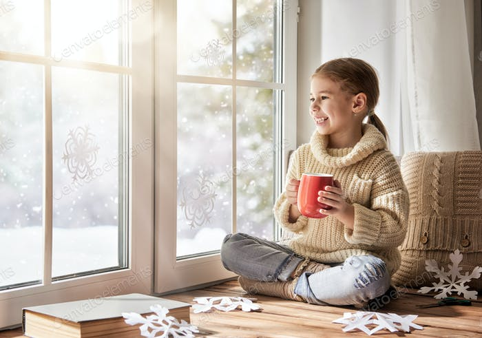 Child makes paper snowflakes