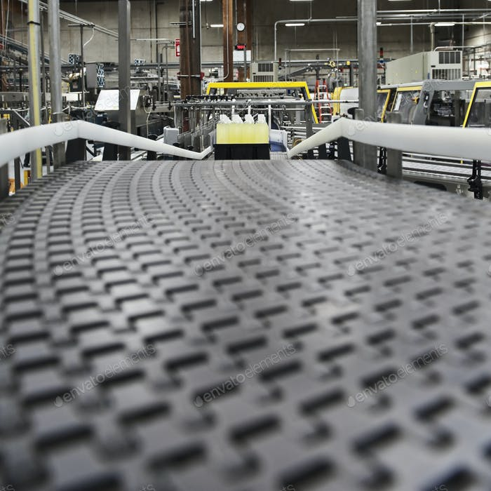 Close up of conveyor belt in bottling plant