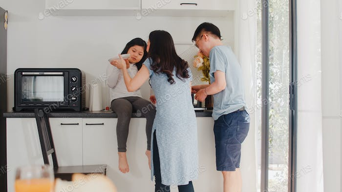 Young Asian Japanese family cooking at home.