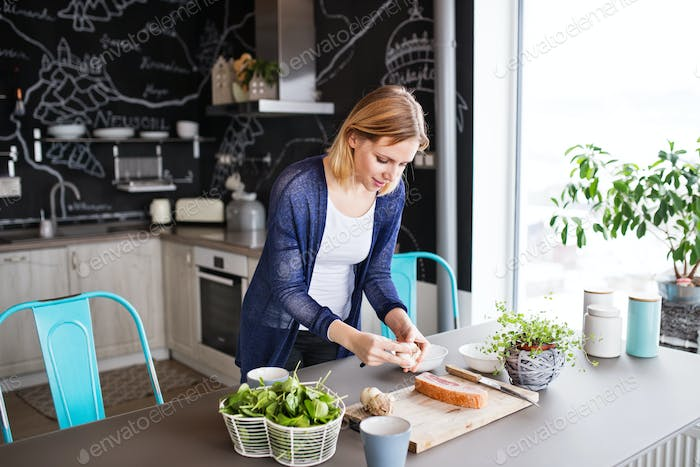 Young woman cooking at home.