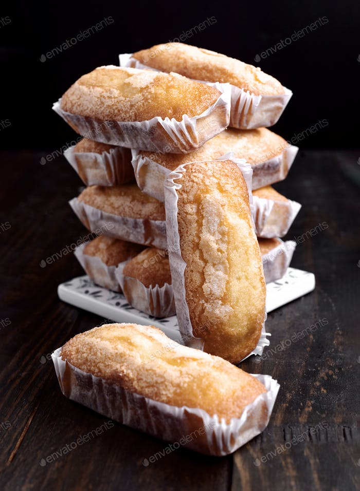 tower of homemade sponge biscuits on dark classic wood