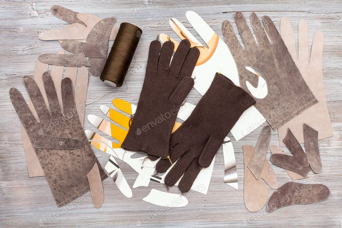 various items for gloves production on table
