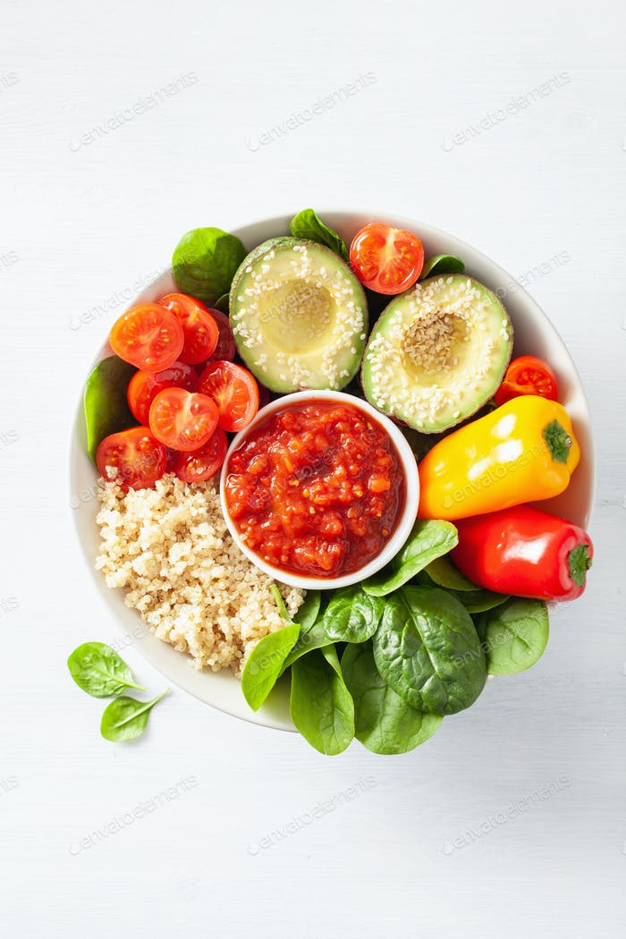 vegan buddha bowl. healthy lunch bowl with avocado, tomato, bell