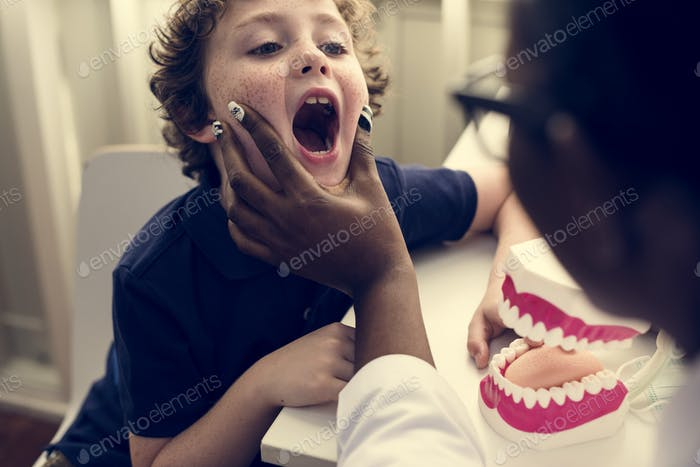 Young boy is meeting a dentist