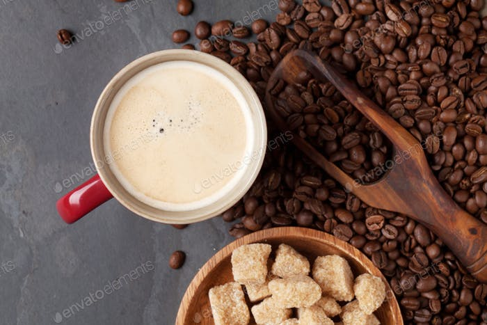 Coffee cup, beans and brown sugar