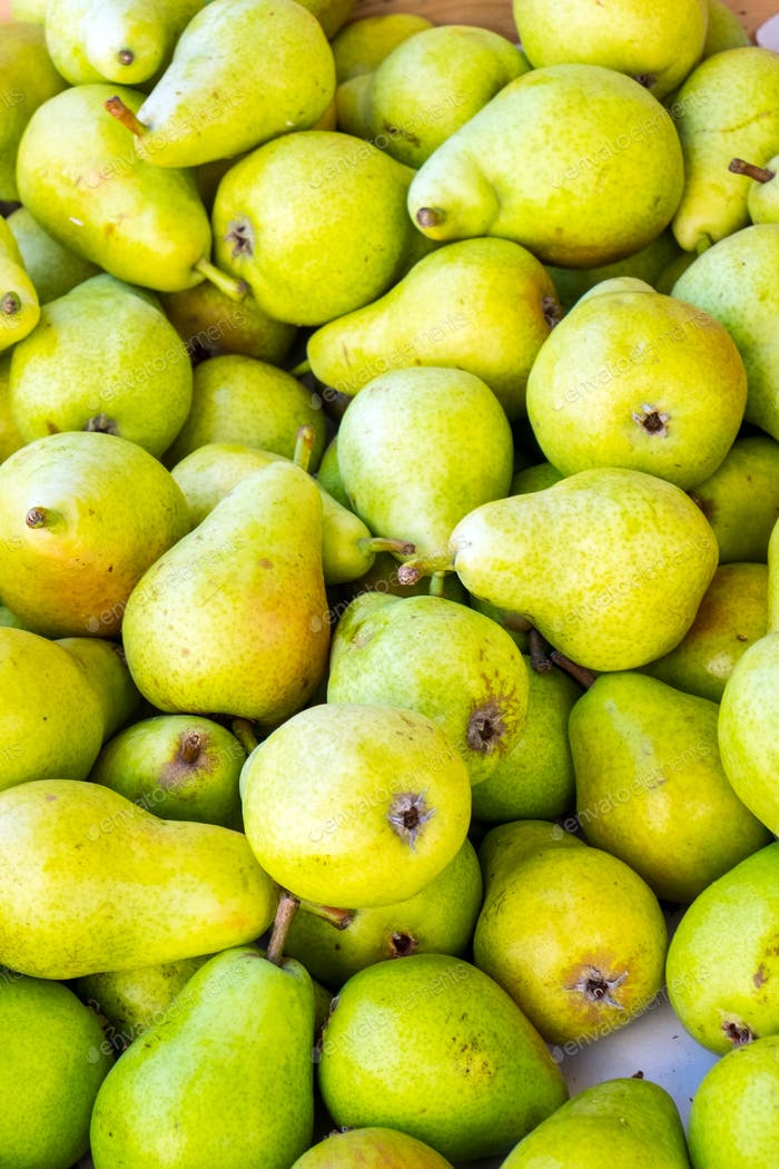 Green ripe pears at the market
