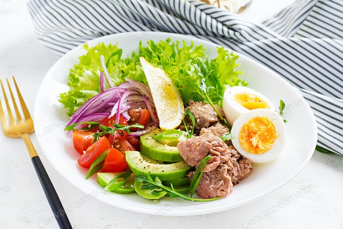 Tuna fish salad with eggs, lettuce, cherry tomatoes, avocado