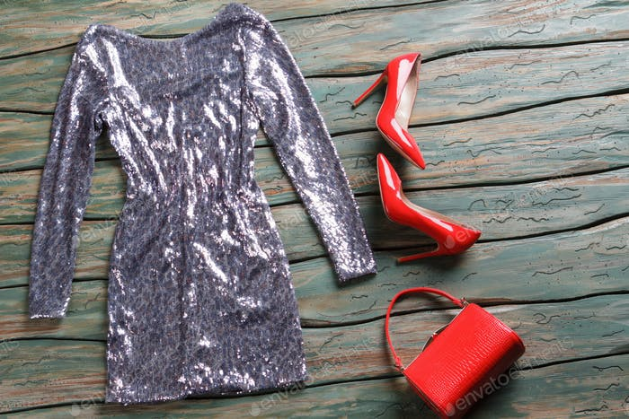 Glossy dress of silver color.