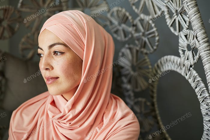 Pensive pretty woman in hijab