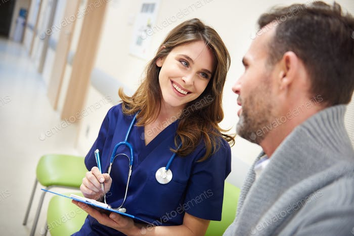 Female surgeon consulting prognosis with patient