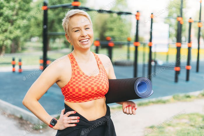 Attractive young woman enjoy sport on street workout area