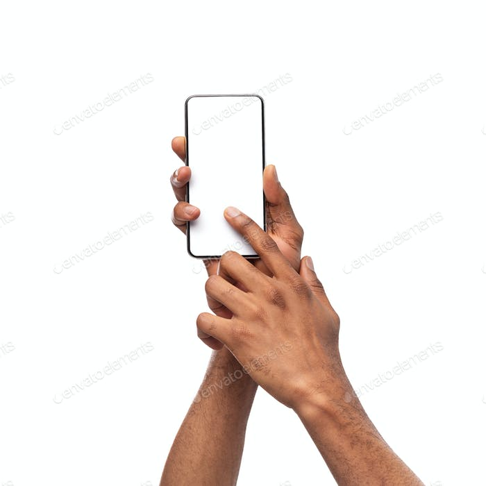 Man holding smartphone with blank screen and pointing on it